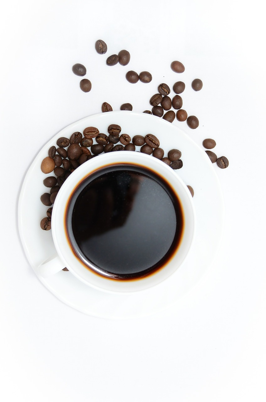 a cup of coffee, coffee beans, coffee